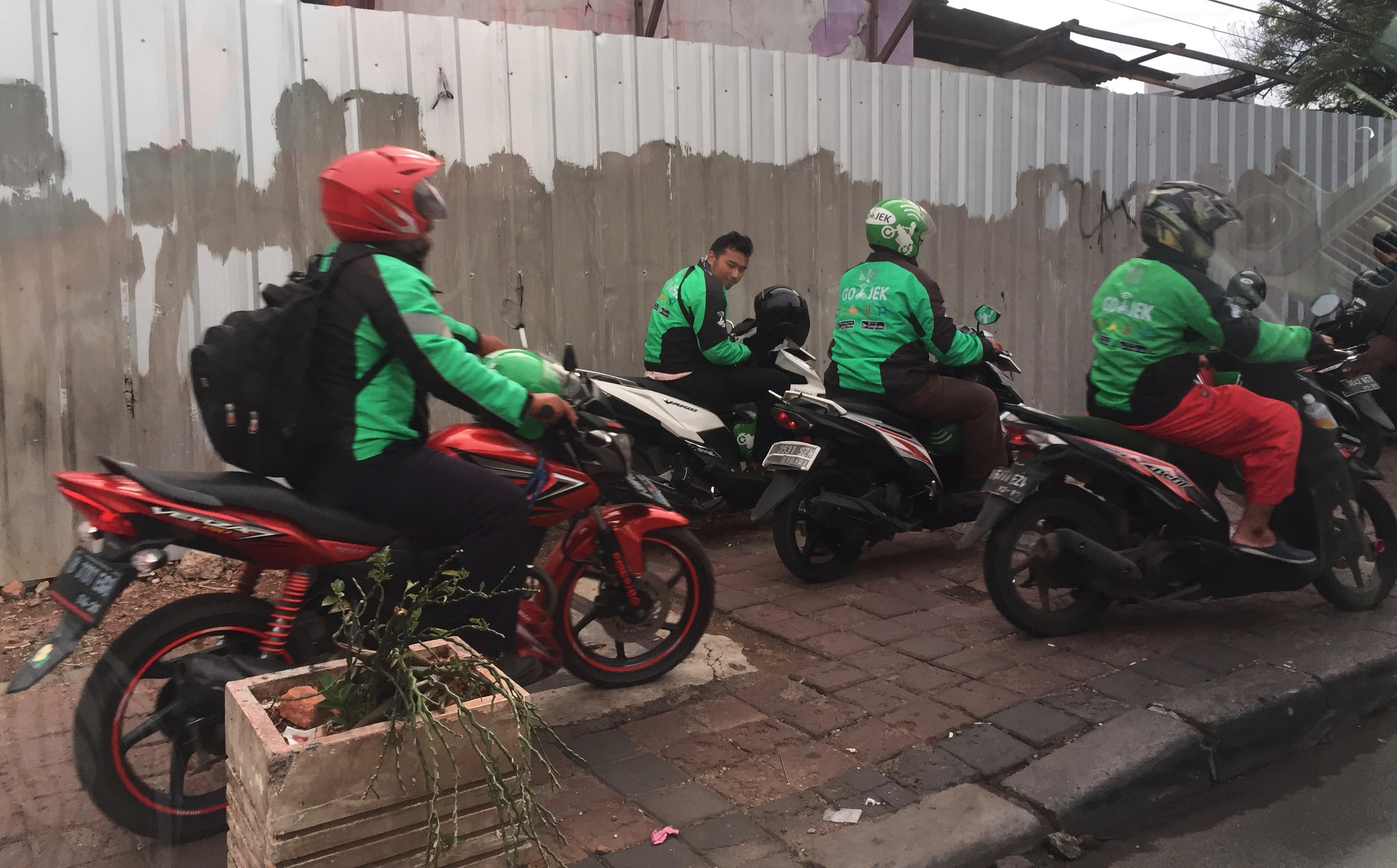 A group of Go-Jek drivers
